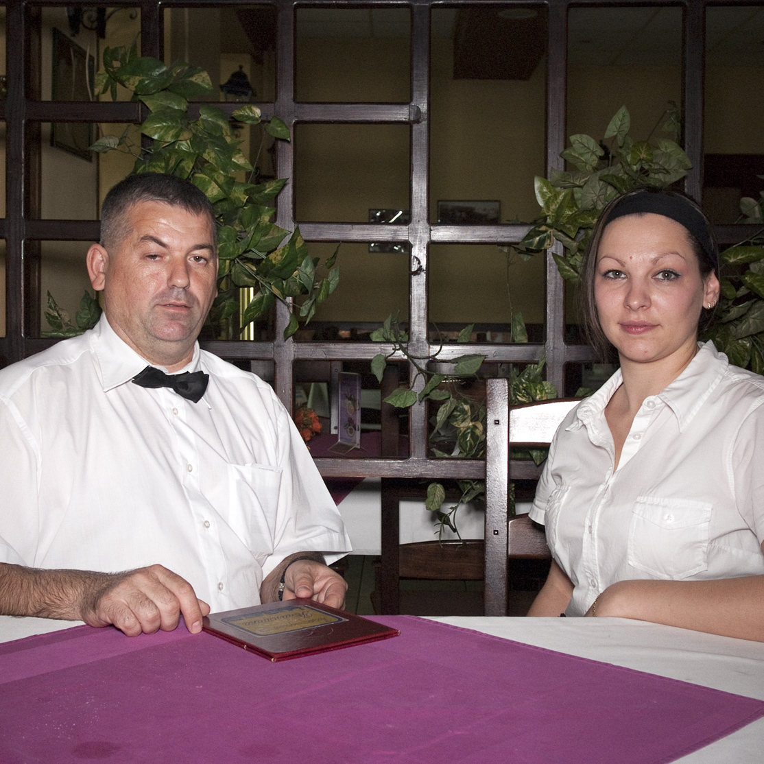 A portrait of a waiter and waitress in restaurant Romantika in Belgrade