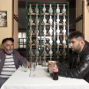 Two men sitting in restaurant Romantika in Belgrade photographed by Iris Uffen